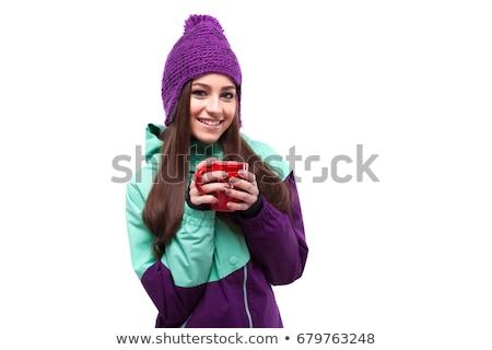young pretty woman in purple ski coat hold cup stock photo © Traimak