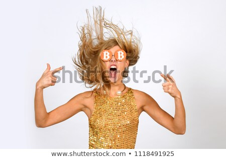 Ecstatic woman with crypto currency coins Stock photo © lovleah