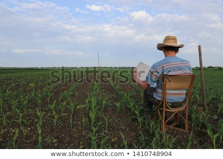 farmer relaxing with shovel Stock photo © IS2