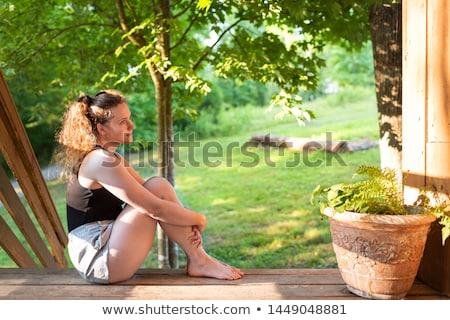 Nő ül növények hát veranda szépség Stock fotó © IS2