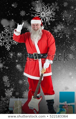 santa claus standing with guitar and various gift stock photo © wavebreak_media