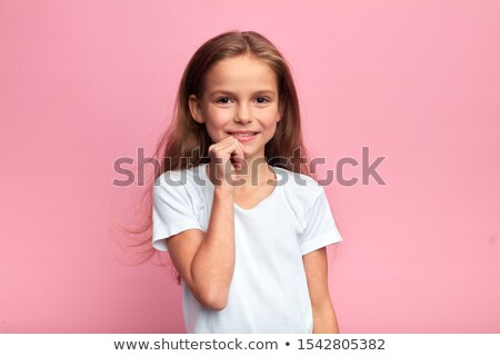 beautiful pensive girl with hand on chin smiling and looking away isolated on white Stock photo © LightFieldStudios
