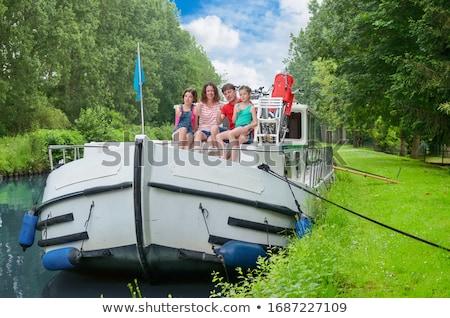 Сток-фото: человека · женщину · лодка · канал · улыбаясь · сидят