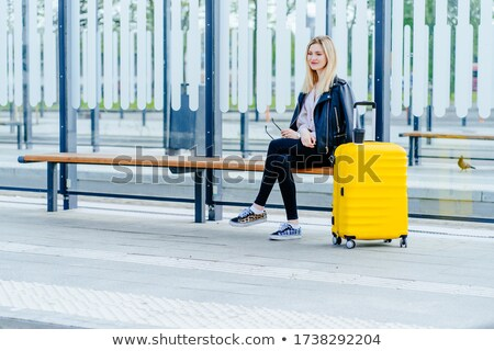Young businesswoman waiting at tram stop Stock photo © IS2