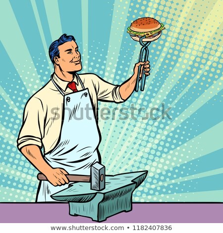 Cook blacksmith forges a Burger on the anvil Stock photo © studiostoks
