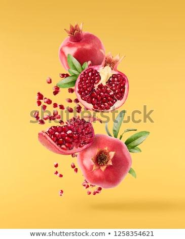 ripe pomegranate halves on board stock photo © dash