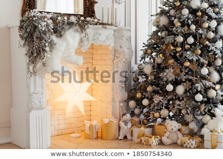 christmas decor gifts candles and fir tree stock photo © karandaev
