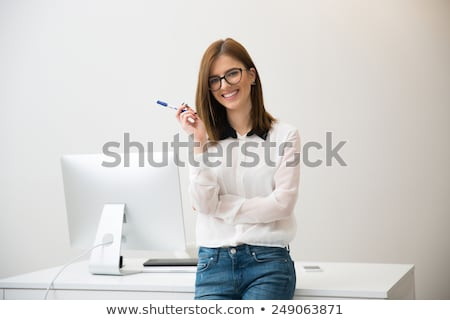 Fiatal lány iroda áll dől asztal tart Stock fotó © Traimak