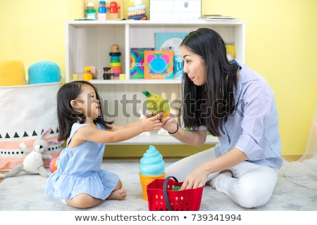 family mother playing with toddler baby Stock photo © Lopolo