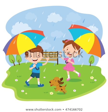 boy and dog running in the park on rainy day stock photo © colematt