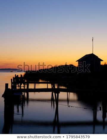 Beautiful sunset and timber jetty silhouette Stock photo © lovleah