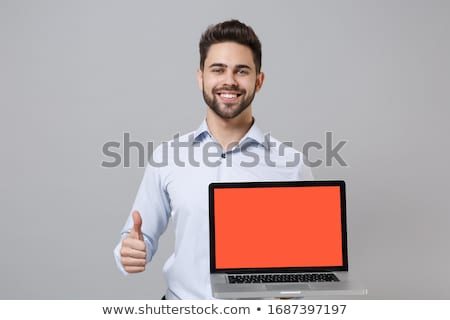 Man holding laptop with financial concept Stock photo © ra2studio