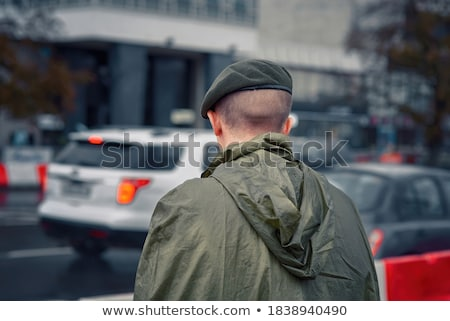 soldier standing in rainy weather Stock photo © ra2studio