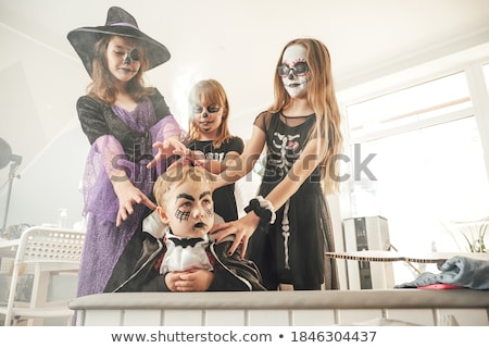 Group of people in masquerade carnival mask posing in studio Stock photo © GVS