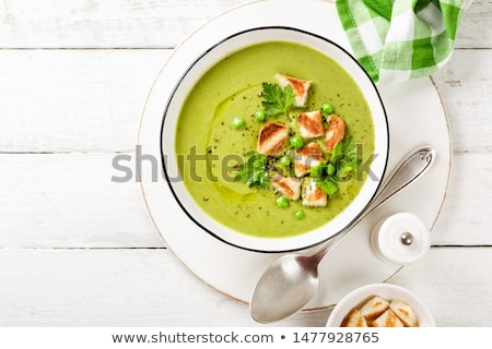 Organic peas soup with crumbs Stock photo © Peteer