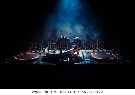 Disc jockey with earphones and cd Stock photo © aladin66