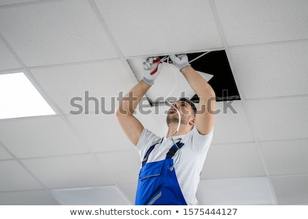 portrait of a man on stepladder Stock photo © photography33