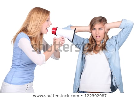 Girls screaming in a bullhorn and girl covering her ears Stock photo © photography33