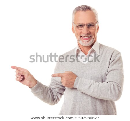 Portrait of an elder businessman pointing away stock photo © stockyimages