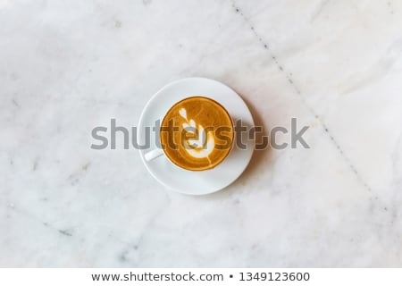 brown porcelain cup with marbled milk froth Stock photo © prill