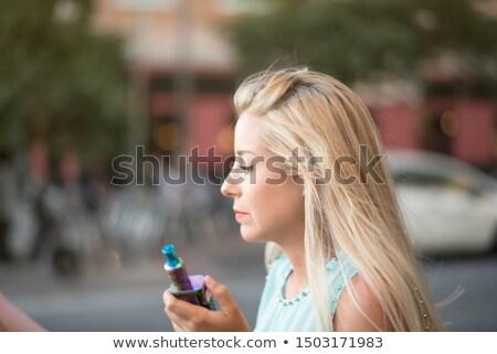 beautiful woman ready to smoke a cigar stock photo © feedough
