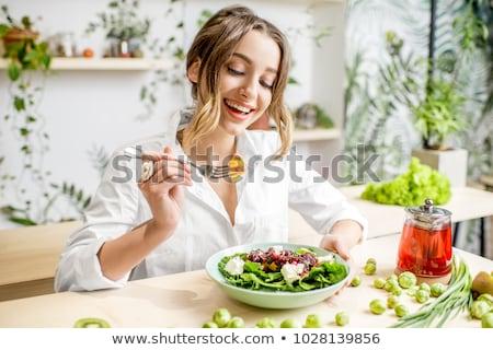 happy girl eating healthy meal  stock photo © OleksandrO