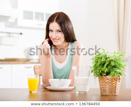 Brunette woman eating strawberry Stock photo © photography33