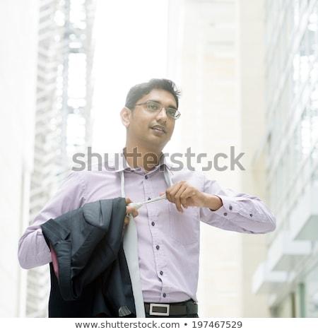 Mature Businessman Loosening His Tie Foto d'archivio © szefei
