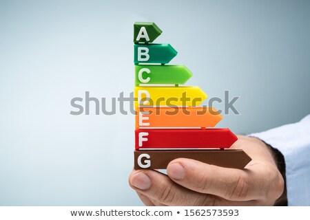 Man energie-efficiëntie teken huis gebouw Stockfoto © photography33