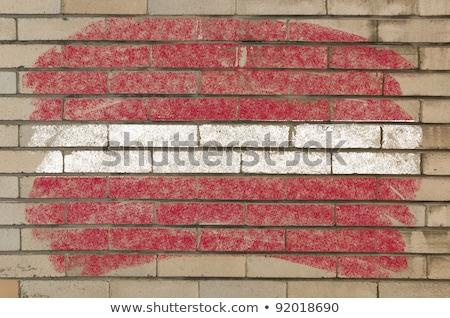zászló · Lettország · grunge · téglafal · festett · kréta - stock fotó © vepar5