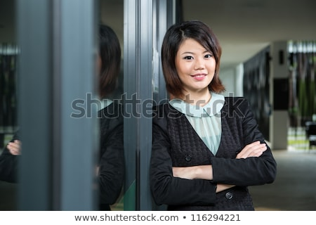Attractive young business woman reflects Stock photo © evgenyatamanenko