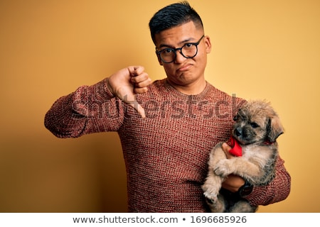 Foto stock: Angry Man With Thumb Down