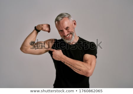 jonge · man · tonen · biceps · sport · bodybuilding · sterkte - stockfoto © kzenon