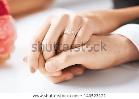 Сток-фото: рук · кольцами · букет · свадьба · пару · цветы