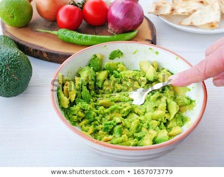 Fresh salad and cherry tomato on fork isolated on white backgrou Stock photo © natika