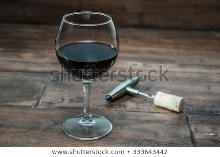 Red wine glass, cork and corkscrew Stock photo © karandaev
