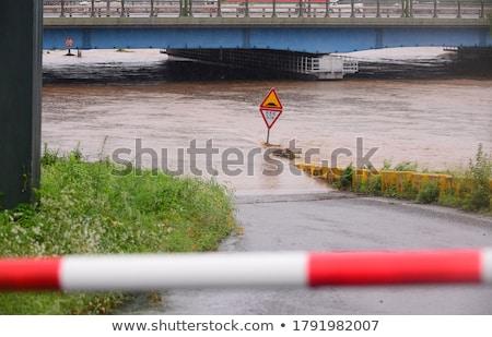 Flooded roadway sign on a bridge Stock photo © njnightsky
