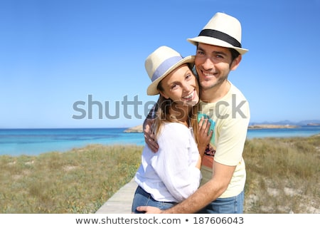 A portrait of a sweet couple in love embracing outdoors Stock photo © deandrobot