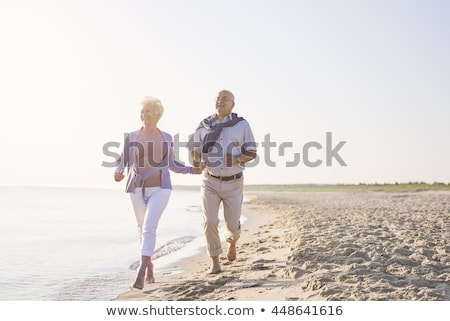 Grandfather with grandmother on sunset at sea running Stock photo © Paha_L