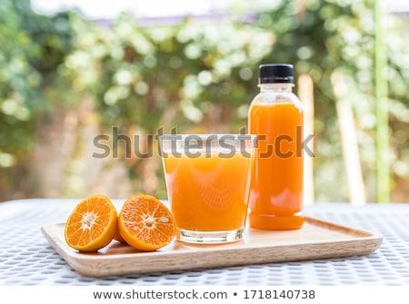 Jugo de naranja plástico botella vidrio alimentos beber Foto stock © shutswis