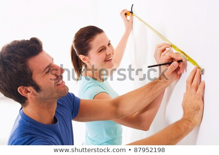 Couple takes measures in new home stock photo © ambro
