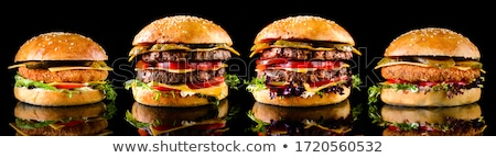 Set of the black burger and classical American burger . Black burger roll slices of juicy marble bee Stock photo © mcherevan