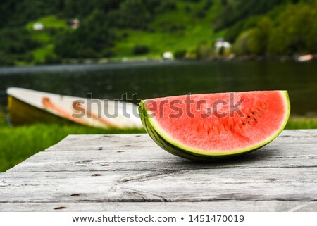 watermelon slices on rustic wooden table stock photo © stevanovicigor
