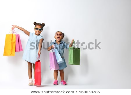 Stock photo: Child with shopping bags