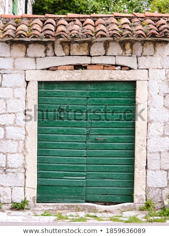 Old stone house in Montenegro - Entrance door Stock photo © simply