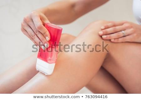 Femminile mano capelli rimozione gambe Foto d'archivio © Giulio_Fornasar