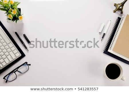 Stock photo: Yellow notebook on office desk, top view