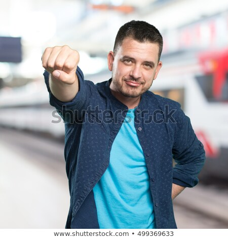 Cool man showing his fists Stock photo © deandrobot