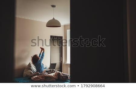 lying down woman wearing underwear Stock photo © phbcz