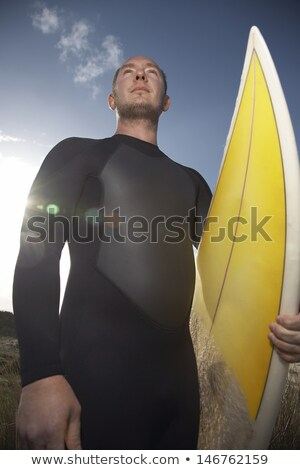 low angle view of man carrying surfboard stock photo © wavebreak_media